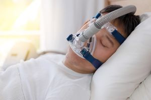A man sleeping with a mask on