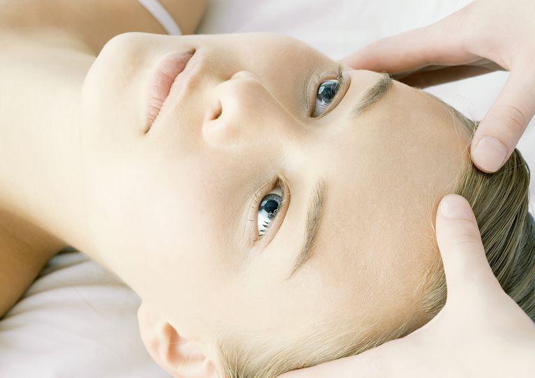 Woman having head massage.