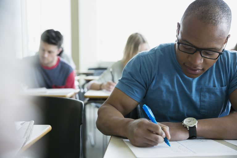 Group of college students taking exam.