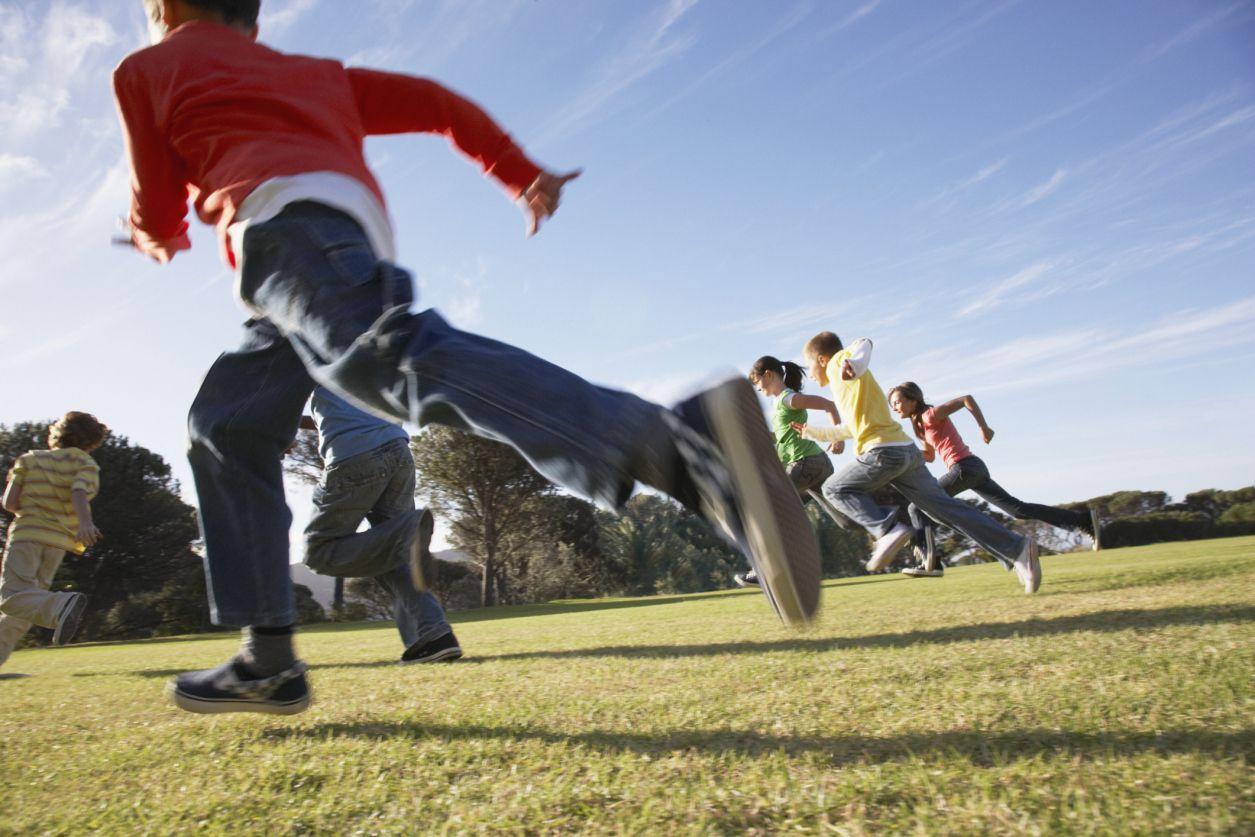 Kids running in a park outdoors