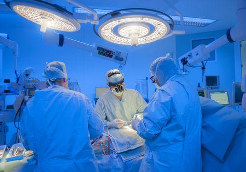 surgeons performing surgery
