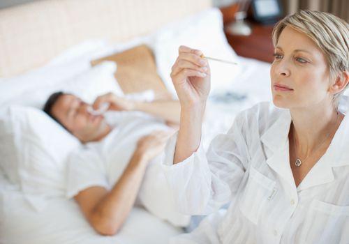 Wife taking hudband''s temperature