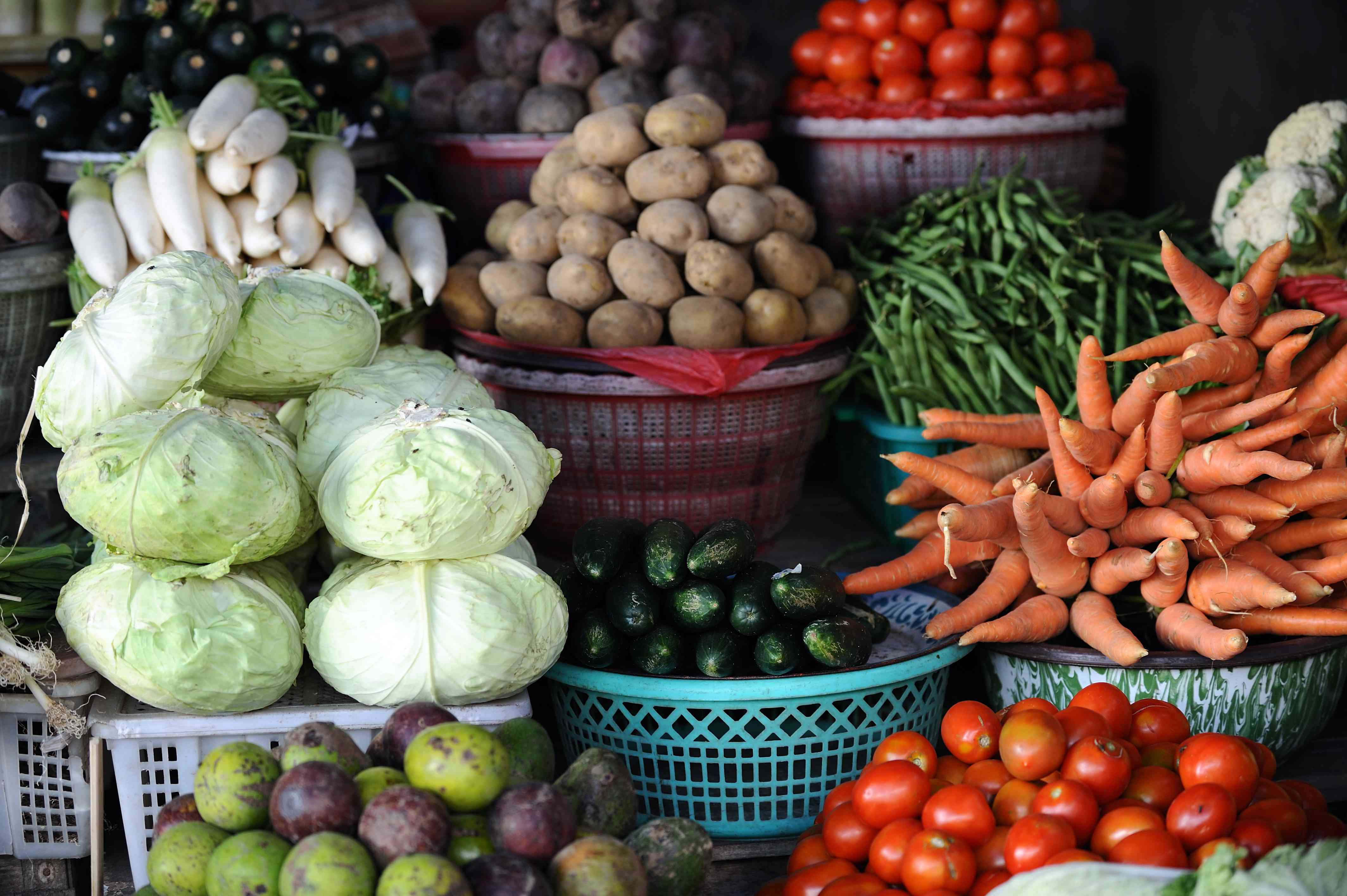 Fresh produce in baskets at a Farmers Market