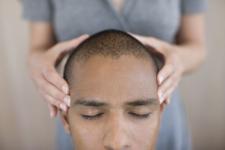 A man getting his head massaged