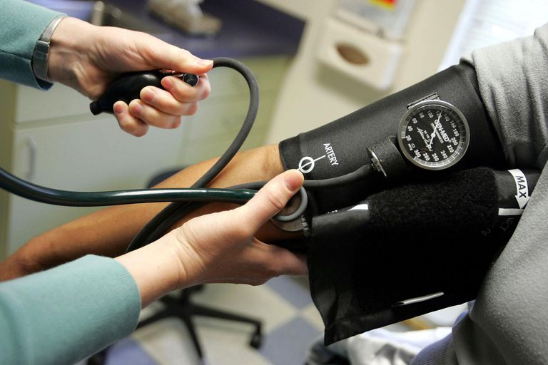 blood pressure cuff on patient