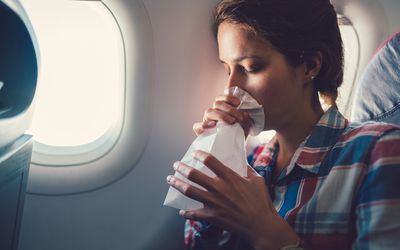 Sick woman with nausea in the airplane