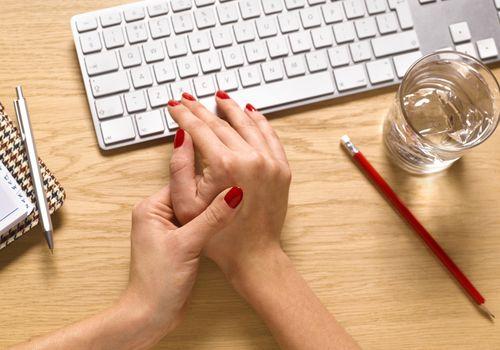 An injured hand next to a keyboard