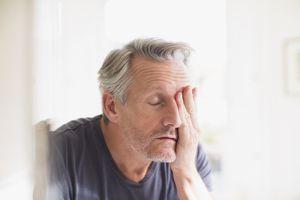 Older man with a headache