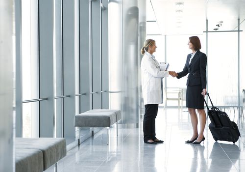 Sales representative talking to a doctor