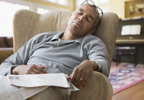 A man dozing while reading