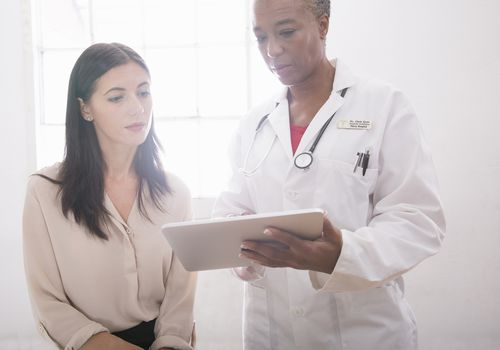 woman and doctor talking