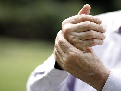 Senior man rubbing sore hand