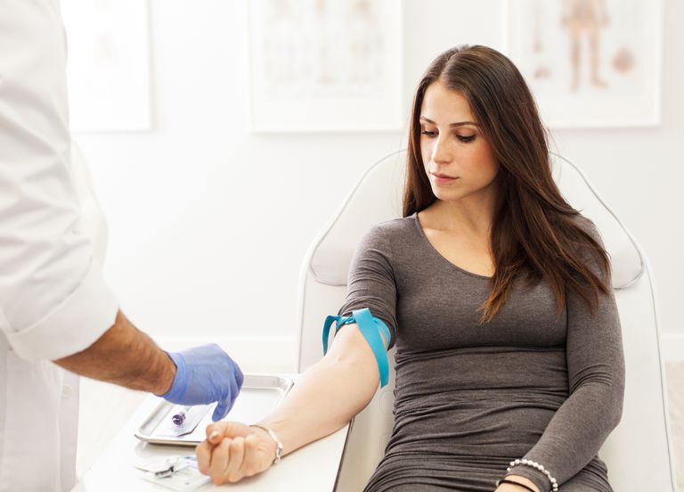 A woman getting her blood drawn for PRP treatment