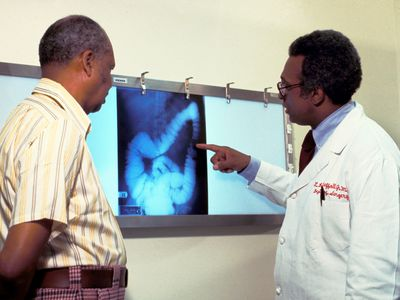 Doctor and Patient View Colon Cancer Screening Image.
