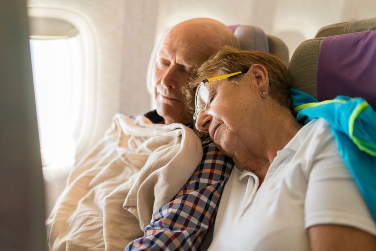 Senior couple sleeping in an airplane