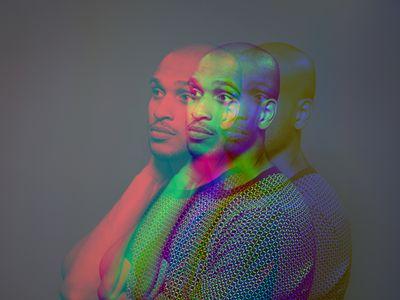 Multiple exposure, portrait a dark skinned male