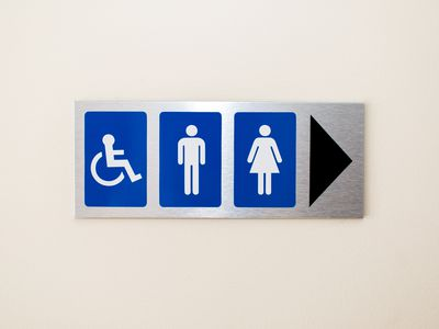 Sign pointing to public restroom
