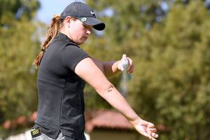 Caroline Inglis sprays sunscreen on the 11th tee during round two of the Hugel-JTBC Championship at the Wilshire Country Club