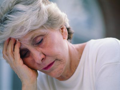 Exhausted woman with arthritis.