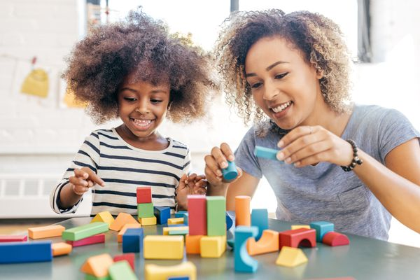 Mom and daughter playing with blocks