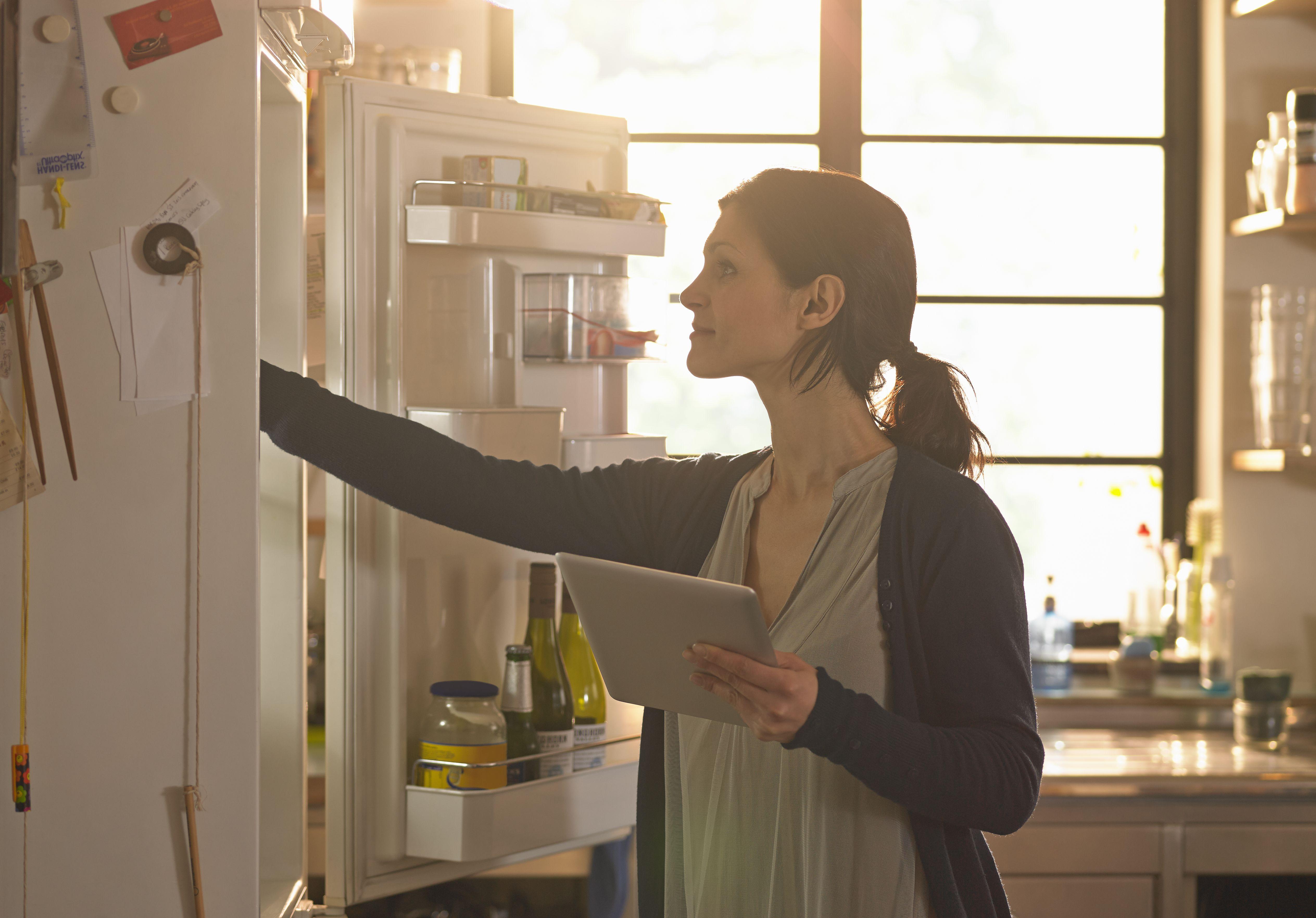 woman at refrigerator