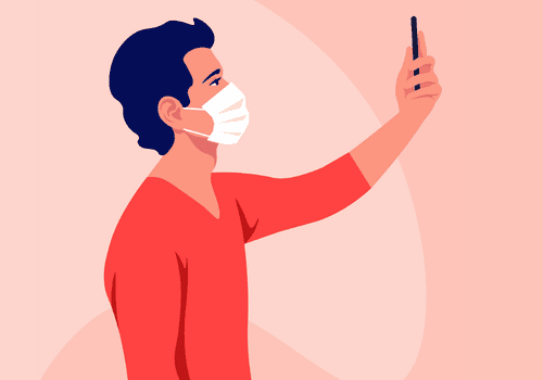 young adult male taking selfie with phone while wearing a mask