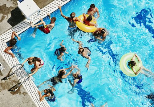 A community pool in the summer.