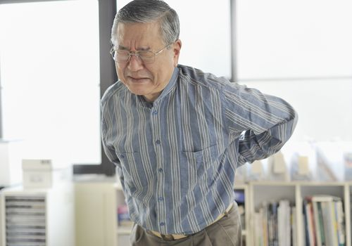 Senior man with lower back pain