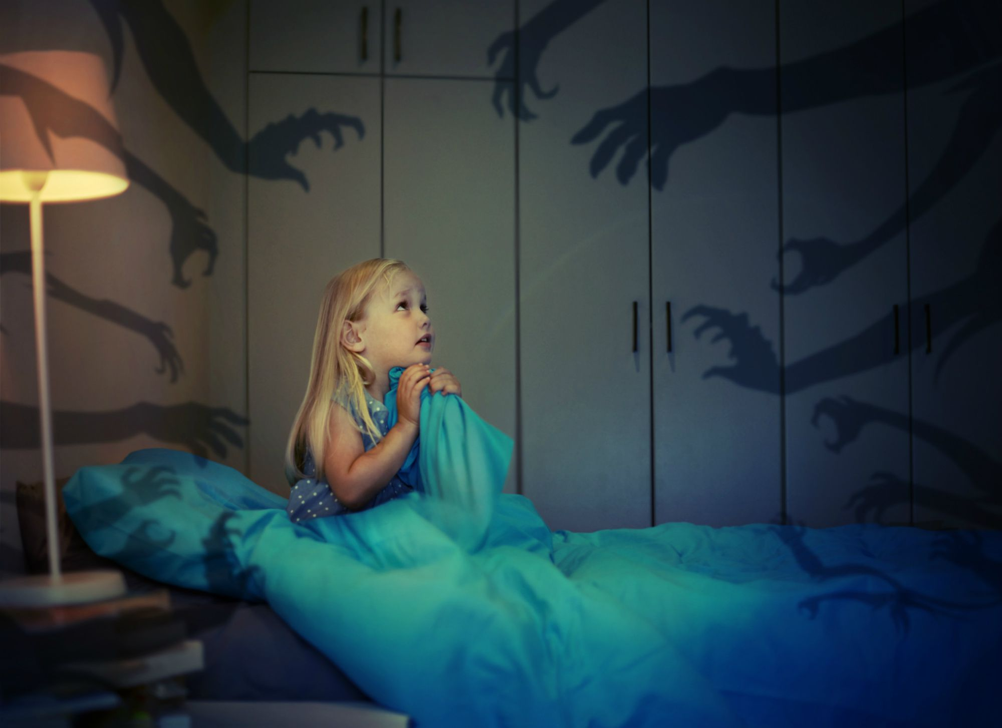 Child in bed with nightmares