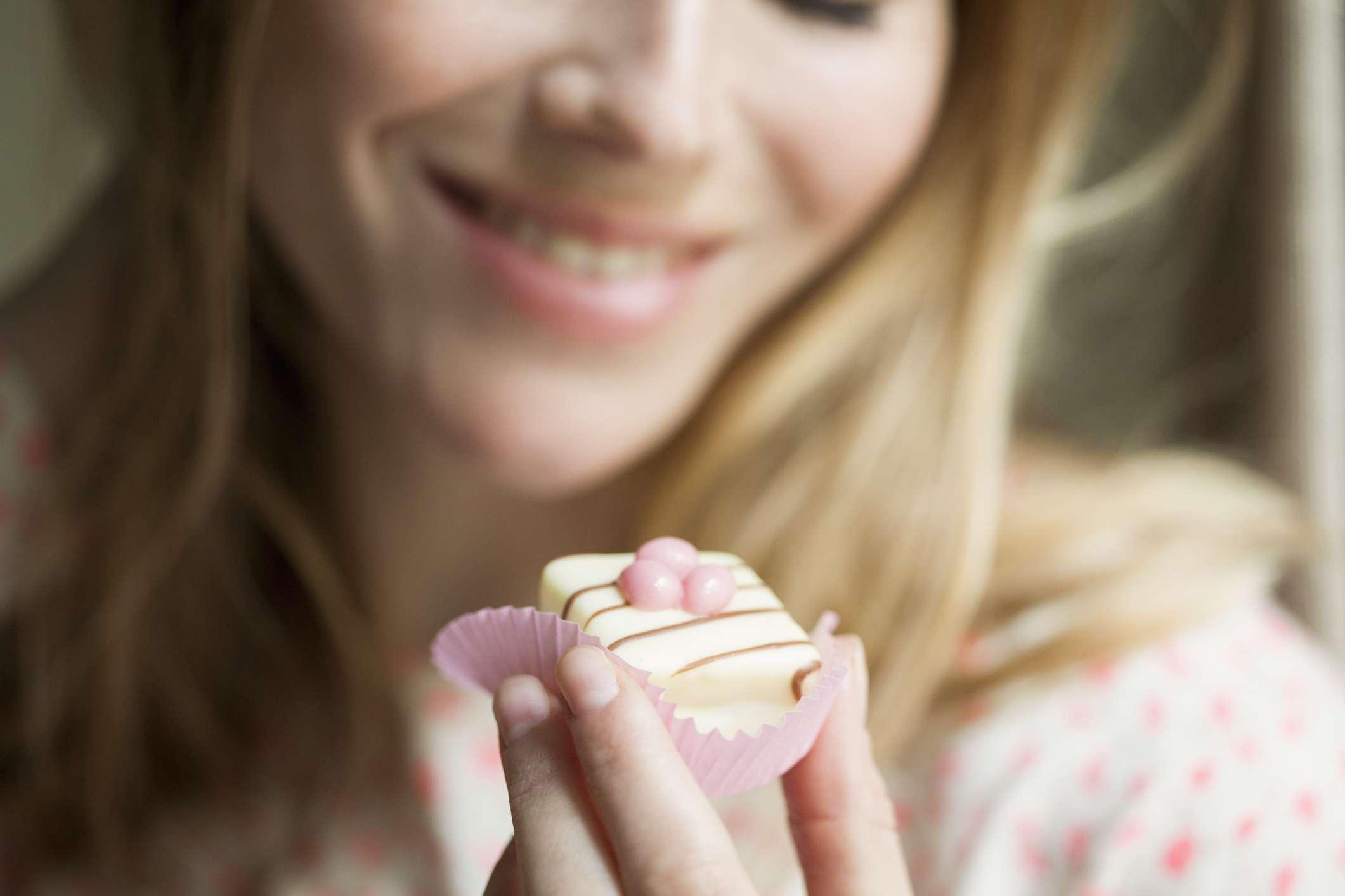 Woman eating a cupcake