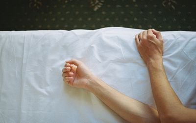 close up of someone's arms while they sleep