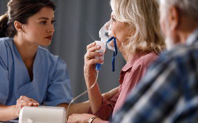 Inhaling through nebulizer at doctor's office!