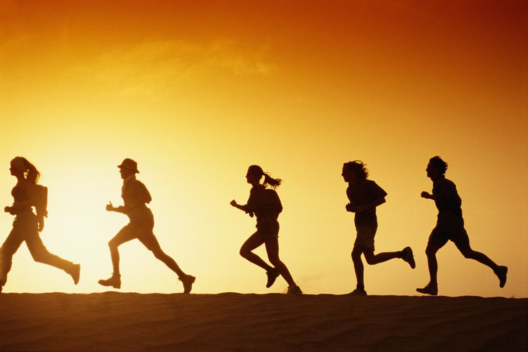 silhouettes of people running in the sun