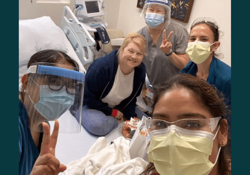islet cell transplant recipient and doctors in masks
