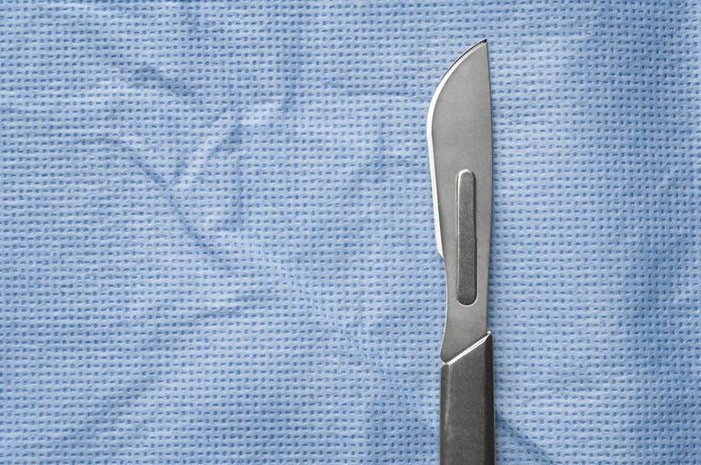 Scalpel on surgical cloth, close-up