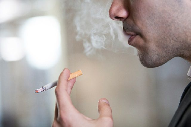 Man Smoking in Public Space