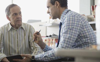 older man talking to doctor