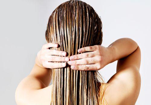 Woman with hair oil treatment