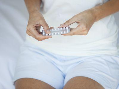 woman taking birth control pill