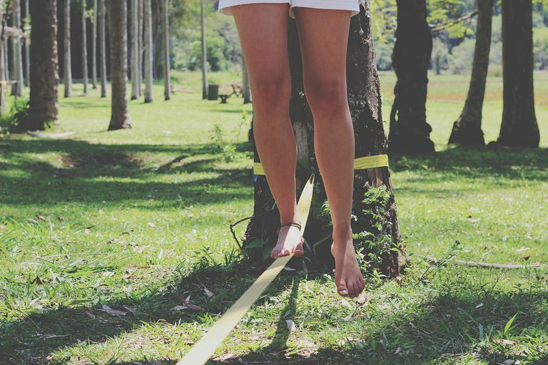Woman balancing on a slack line