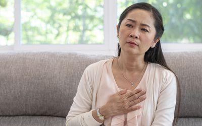 Woman feeling chest tightness
