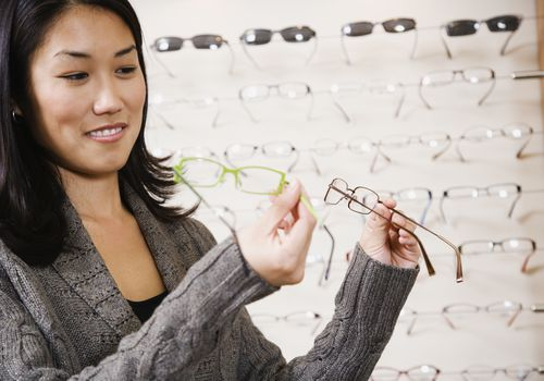 Woman comparing frames at the eye doctor