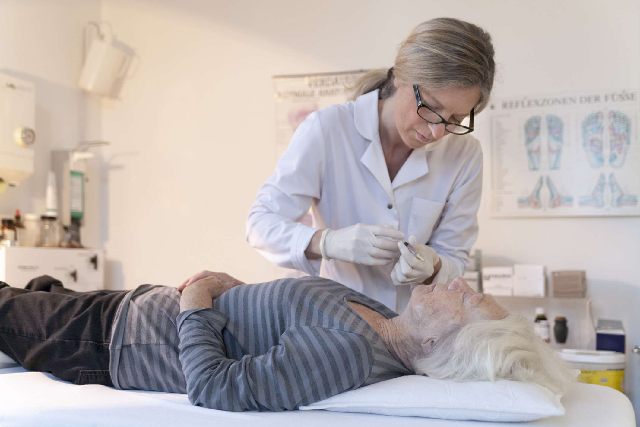 Older woman having acupuncture performed on her