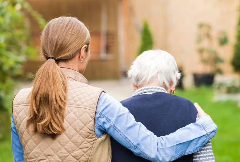 Woman with arm around elderly woman