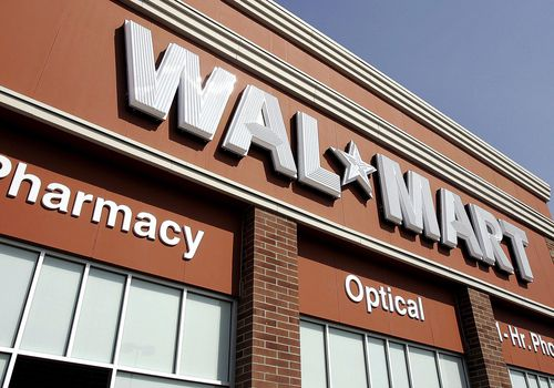 The world's largest retailer, Wal-Mart's sign hangs above one of its soon to be opened locations September 21, 2006 in Chicago, Illinois.