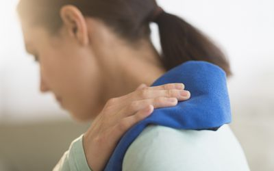 Woman icing her shoulder