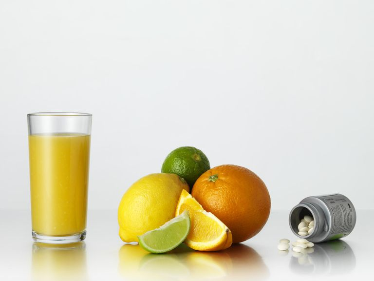 Sources of vitamin C including orange juice, and supplements pills