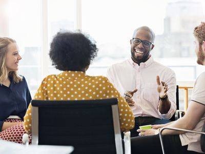 small group of smiling employees in a meeting