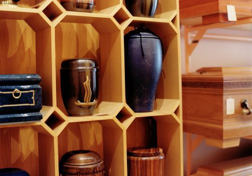 Urns on a shelf