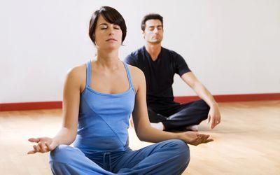 man and women doing yoga